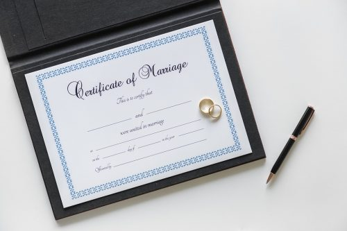 Certificate of marriage that binds two individuals in a legal commitment that needs to respected and accepted.